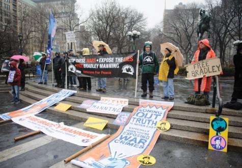 Protestors brave rain for prisoner Bradley Manning