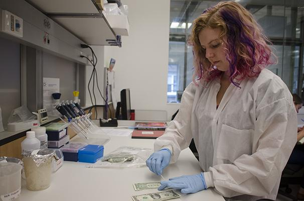 Professor's study finds microbes on dollars