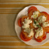 Burrata can be simply prepared with sliced tomatoes and fresh basil.
