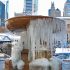In Bryant Park a fountain freezes over in the cold of winter.