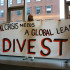 Members of NYU Divest demonstrate during the University Senate meeting last Thursday.