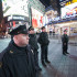 Police officers stand in Times Square following the Eric Garner decision.