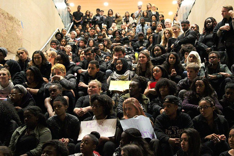 A+crowd+of+students+and+faculty+filled+the+lobby+of+Kimmel+Center+on+Monday+evening+in+a+show+of+solidarity+for+students+of+color.