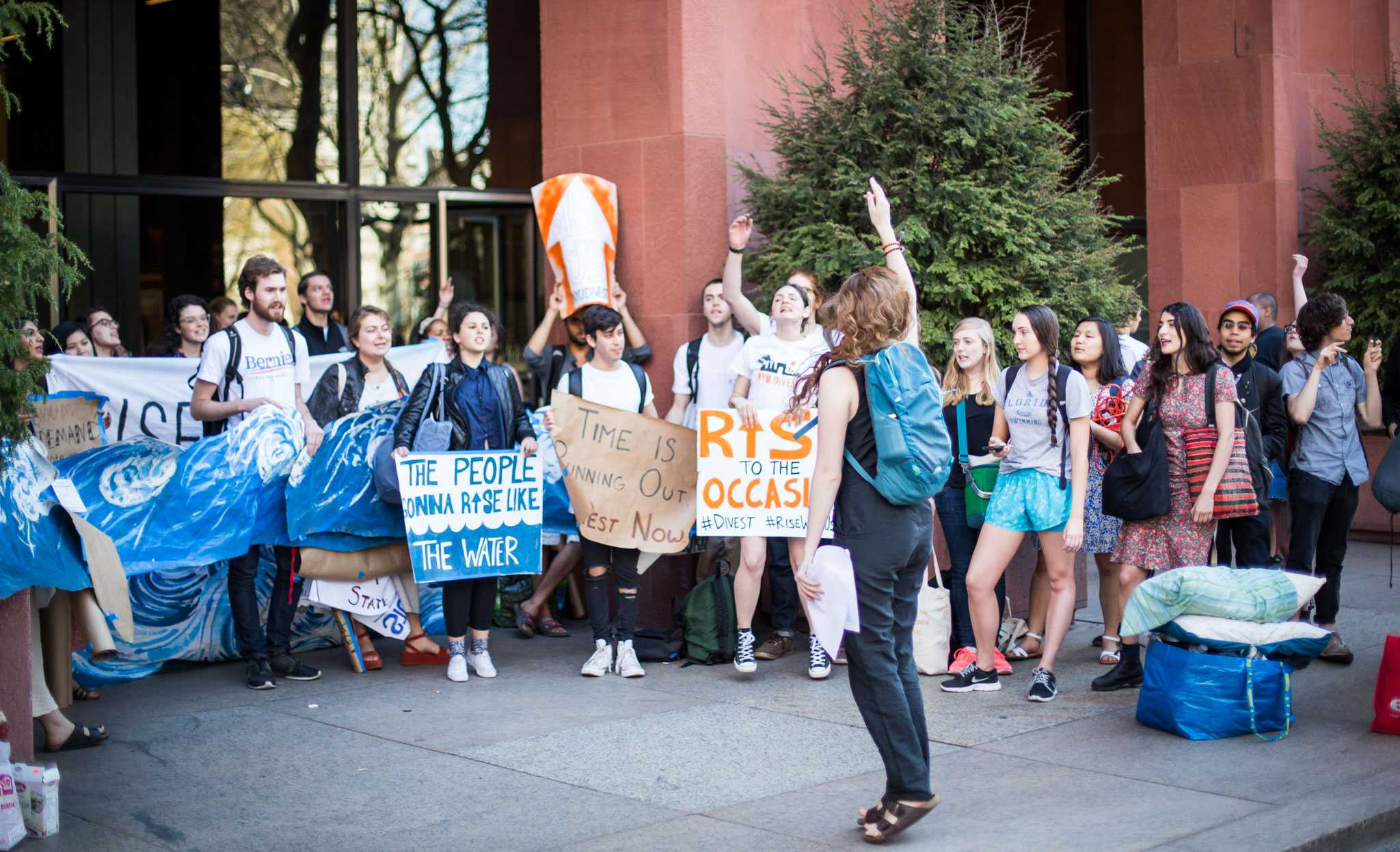Members of NYU Divest rally outside of Bobst Library in April.