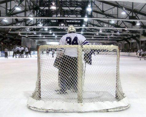 The NYU hockey team playing at their home ground of Chelsea Piers. Spencer Varney and Mike Martin are the assistant coaches of the team, with the head coach being Chris Cosentino and goaltending coach, Dan Fortunato.