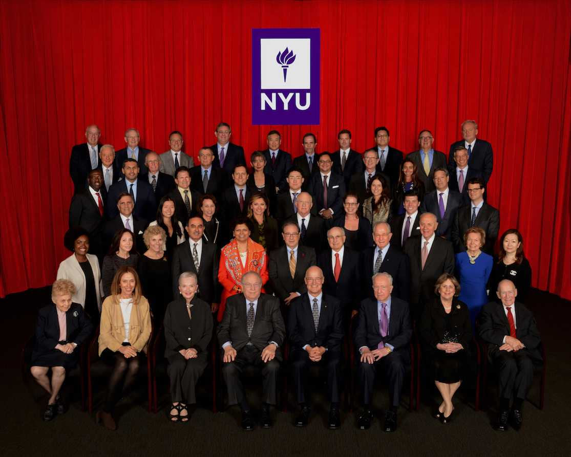 NYU's Board of Trustees with Andrew Hamilton in September 2016. The board of trustees has recently faced pressure from student groups to increase transparency and student involvement in the board.