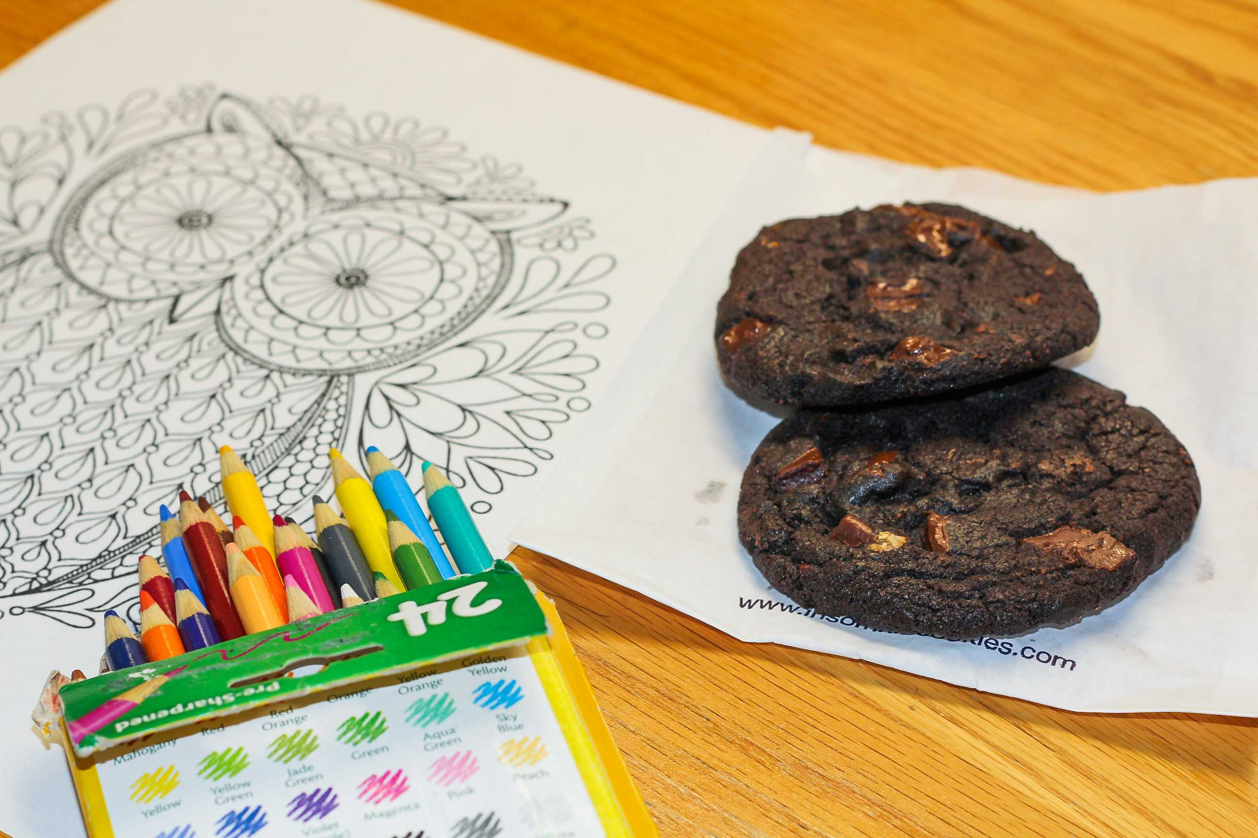 """Eating cookies and coloring books make for de-stressing fun in NYU's club, """"Cookies and Coloring."""""""