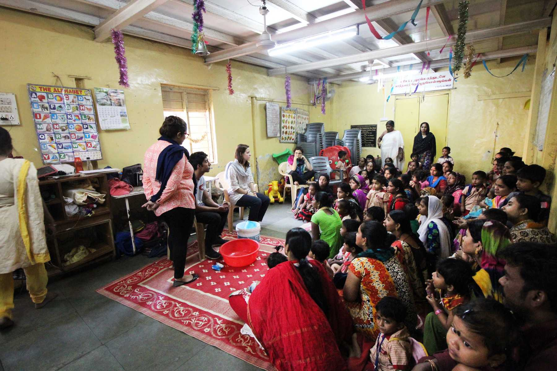 CAS senior Darshan Mahabare teaches a classroom of children, mothers, teachers and social workers in Mumbai how to wash their hands. Mahabare, alongside Kanyon Iwami, is a representative of KickToChange, an organization that raises funds by teaching soccer in order to provide hygiene kits for communities that need it.