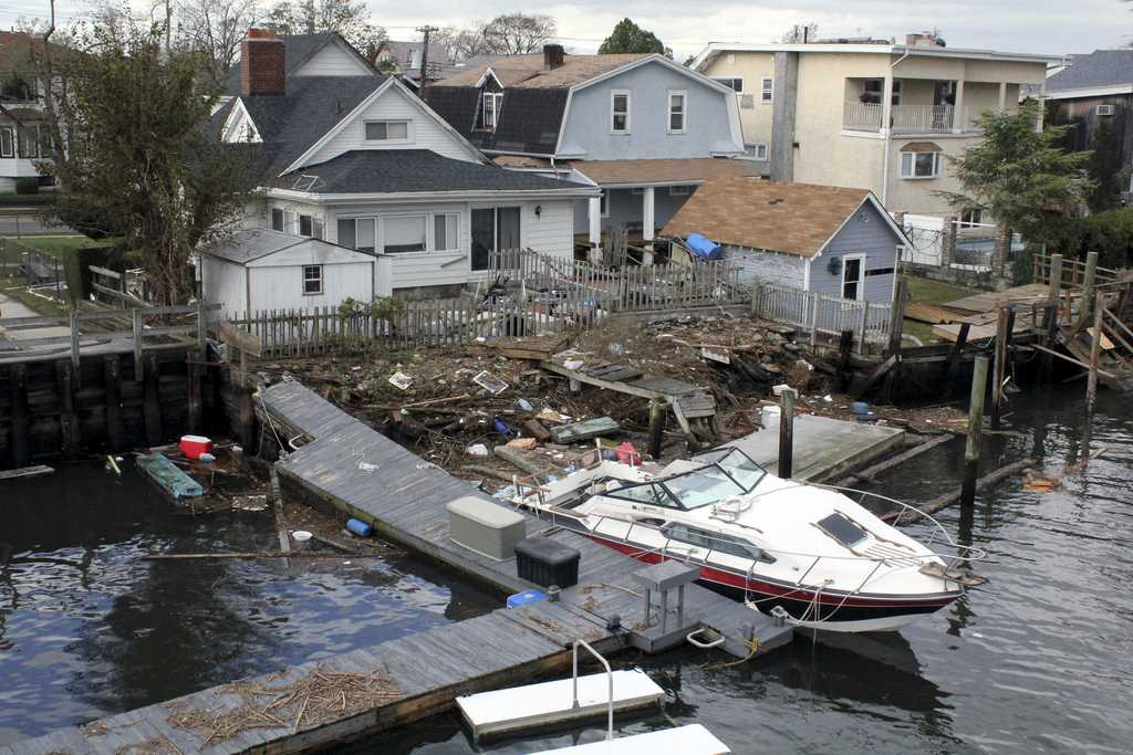 The aftermath of Hurricane Sandy includes the destruction of property on Howard Beach. NYU's Population Impact, Recovery and Resilience program is working on examining communities impacted by the disasters as well as the steps towards recovery.