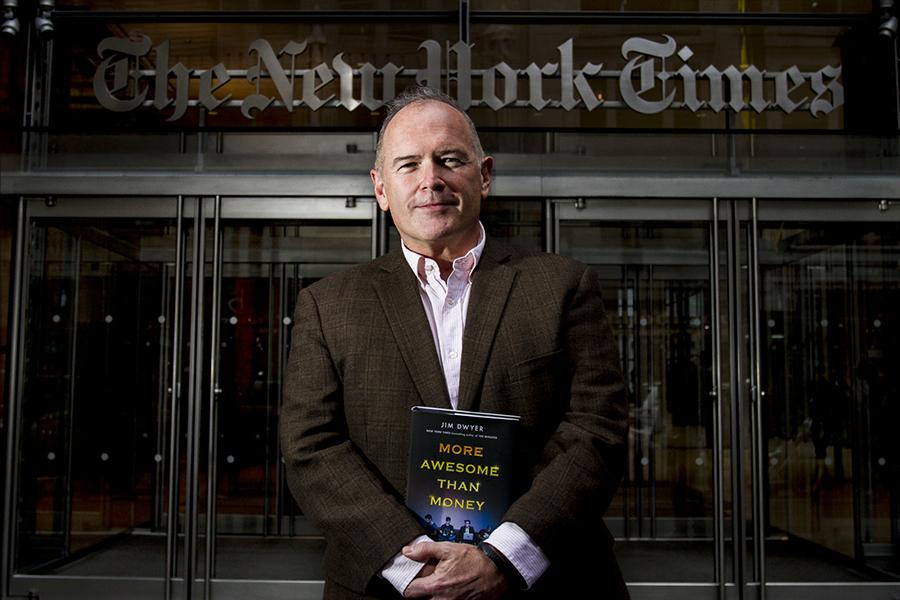 Columnist+Jim+Dwyer+stands+in+front+of+the+New+York+Times+building+with+his+new+book%2C+%22More+Awesome+than+Money%2C%22+about+four+NYU+undergraduates+who+attempted+to+create+a+new+social+network.