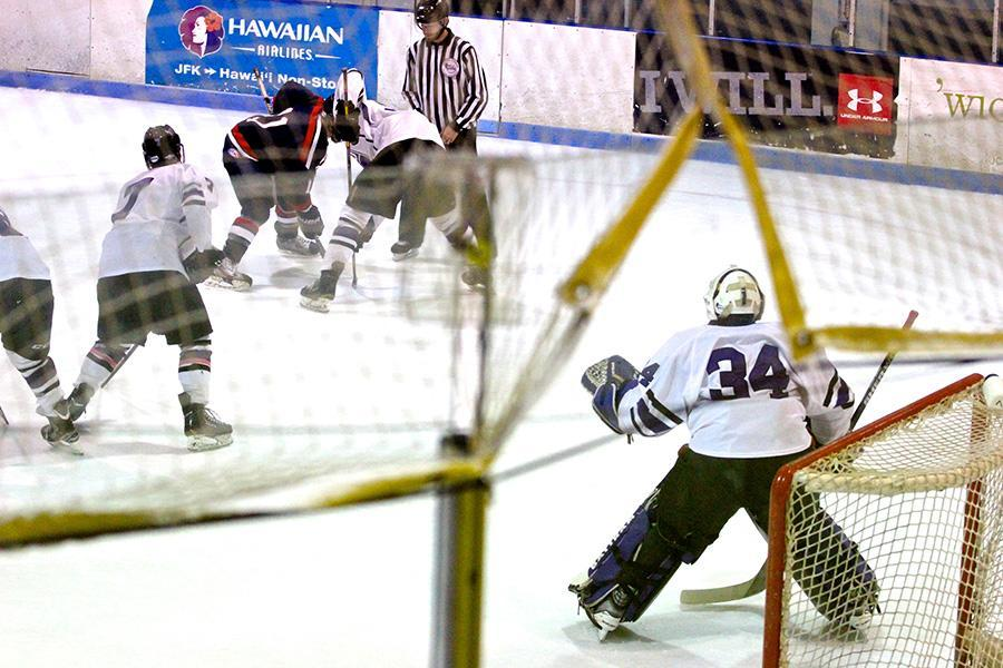 Starting goalie Sam Daley gets ready during a defensive zone faceoff.