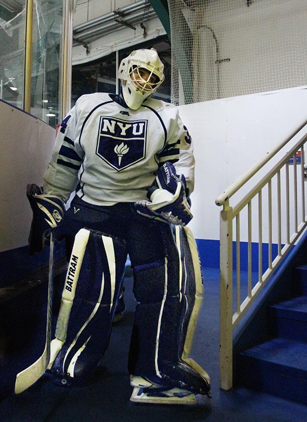 Goaltender Sam Daley walks to the locker room between periods.