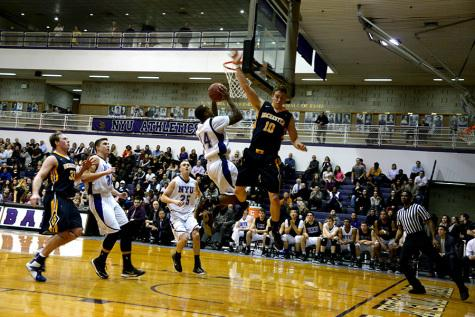 One win, one loss for basketball team during Friday games