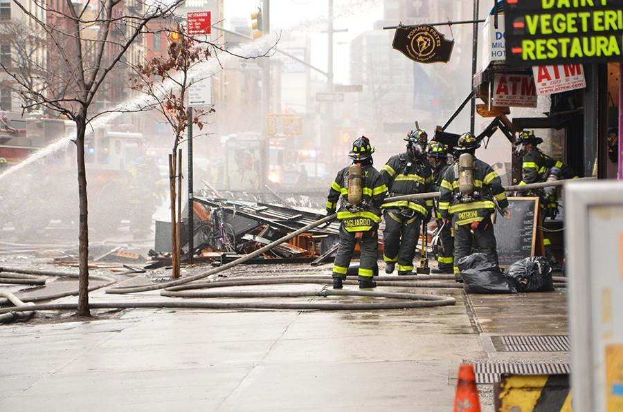 Firefighter+rush+to+put+out+the+blaze+cause+by+a+gas+explosion+near+St.+Marks+Place.