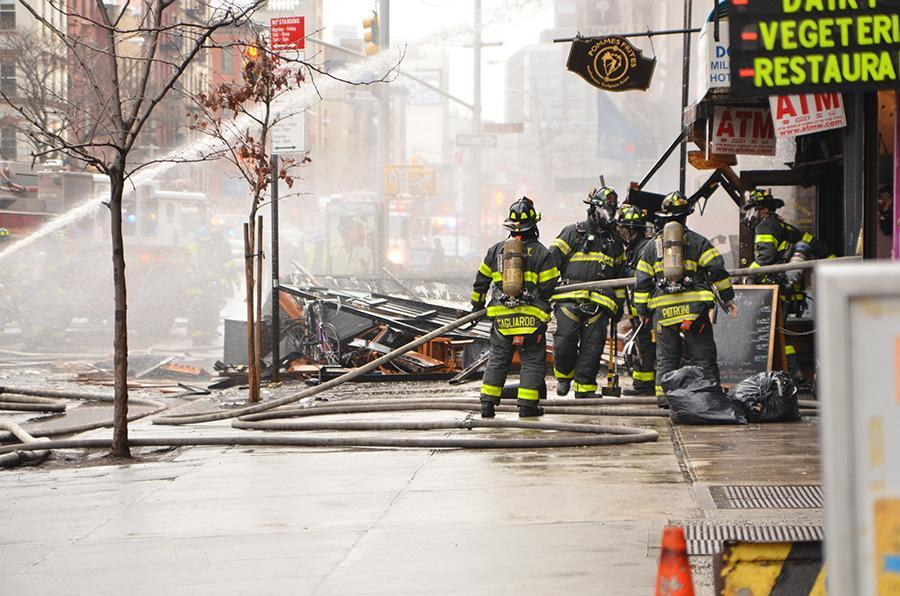 Firefighter rush to put out the blaze cause by a gas explosion near St. Marks Place.