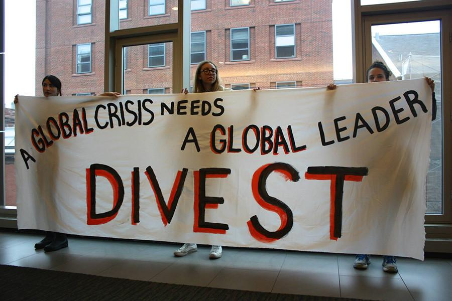 Members+of+NYU+Divest+demonstrate+during+the+University+Senate+meeting+last+Thursday.