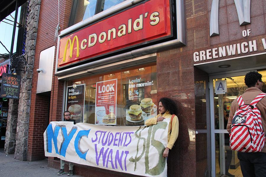 Members of SLAM occupy the McDonald's on Broadway demanding higher minimum wages.