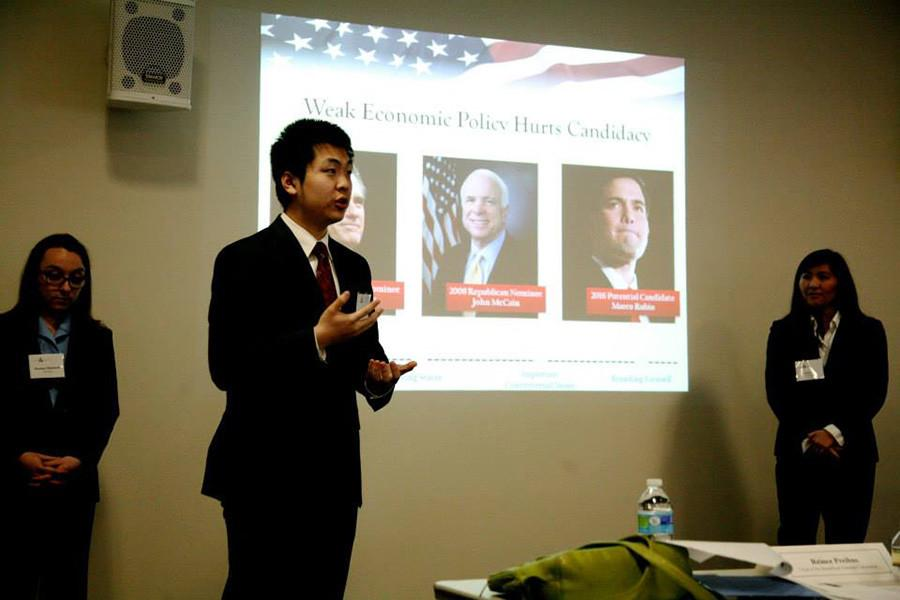 Joe+Wang%2C+center%2C+presents+on+domestic+policy.+His+team%E2%80%99s+presentation+won+the+final+round+of+NYU%E2%80%99s+second+Public+Policy+Case+Competition+on+Saturday.