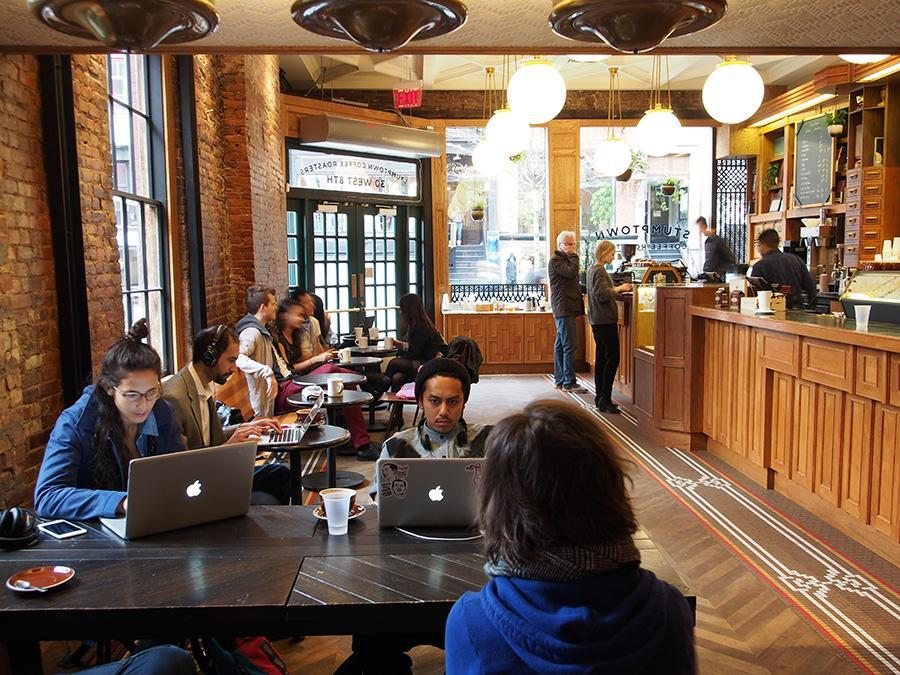 Customers using laptops at Stumptown Coffee Roasters on 8th street.