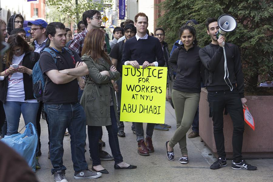 Protesters+rally+outside+of+Bobst+for+the+compensation+of+Abu+Dhabi+workers+affected+by+labor+rights+violations+on+Friday.