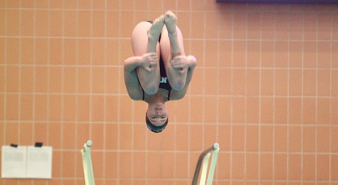 Training pays off for Violet swimmers and divers