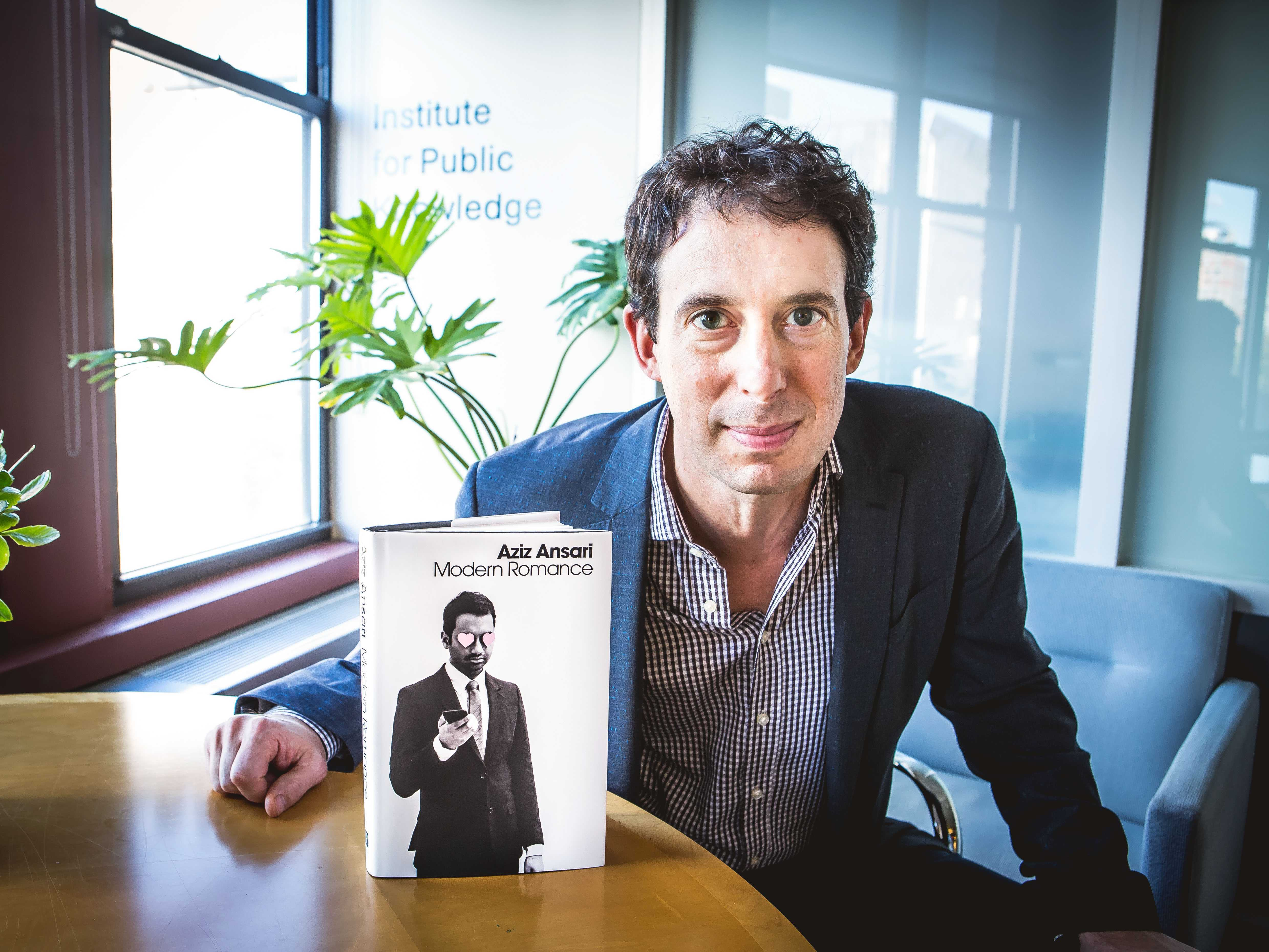 """Eric Klinenberg, Professor of Sociology at NYU, is pictured with his recently published book, """"Modern Romance"""