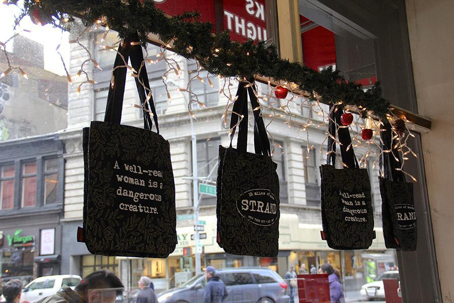 Lights and garland hang in the windows at The Strand, spreading holiday cheer to those just passing by.