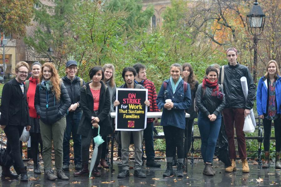 Braving+the+rain%2C+students+gather+in+Washington+Square+Park+to+protest+wages+provided+by+NYU+for+their+student+employees.+