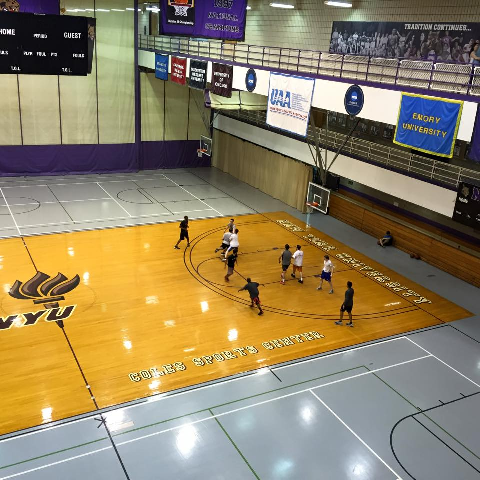 NYU students participate in a pickup basketball game at Coles Athletic Center.