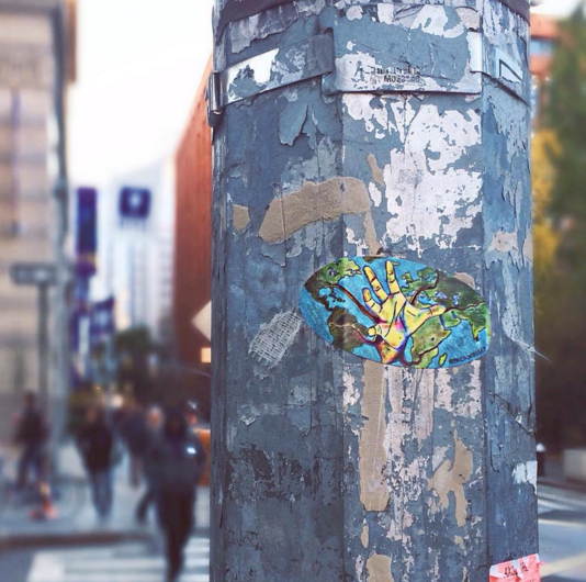 """NYU Senior, Madison McCormick, is currently working on a sticker series titled """"#crumblingborders"""" in a bid to raise awareness of the Syrian Refugee Crisis."""