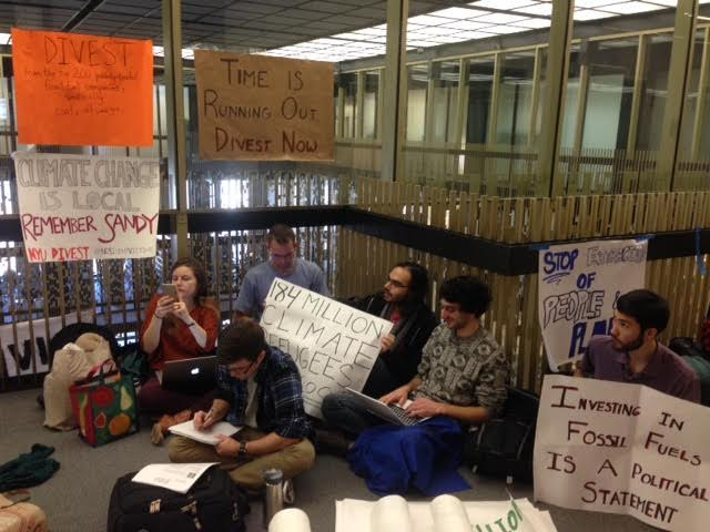 NYU+Divest+members+sit-in+on+the+12th+floor+of+Bobst+Library+waiting+to+confront+university+administrators.