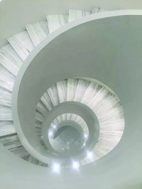 As+the+centerpoint+of+the+new+Barneys+flagship%2C+the+spiral+staircase+leads+customers+through+retail+heaven.