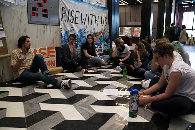 NYU+Divest+members+occupied+part+of+the+first+floor+of+Bobst+Library%2C+blocking+the+elevator+that+leads+to+executive+offices+on+Monday%2C+April+18%2C+demanding+to+meet+with+the+Board+of+Trustees+who+would+vote+on+divestment+at+their+next+meeting.
