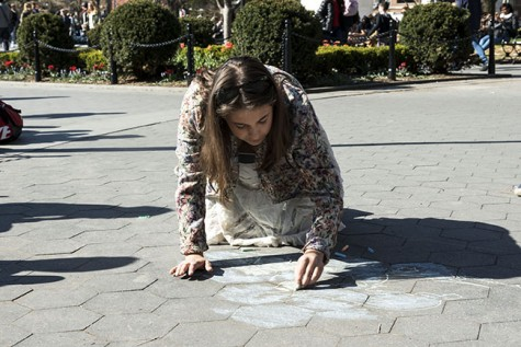 Organizers of the event chalk to attract the attention of people in Washington Square Park.