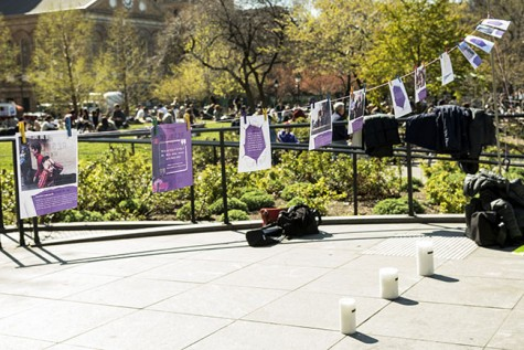 During the rally in Washington Square Park on April 16, CAS professor Colette Mazzucelli and her students created an installation of placards and candles.