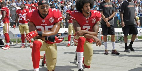 Kaepernick Stands Up By Taking A Knee