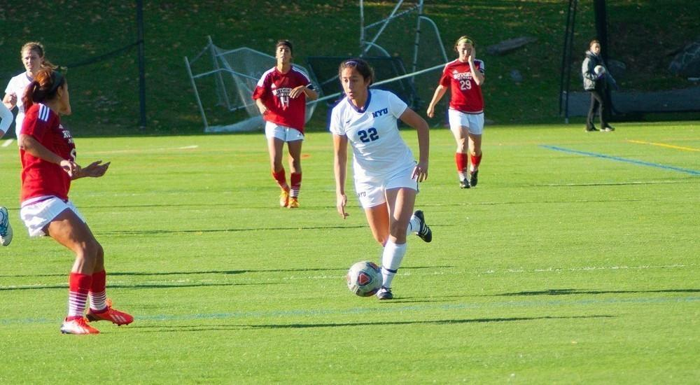 Sophomore Maddie Pena, determined, makes her way to score final goal off an assist.