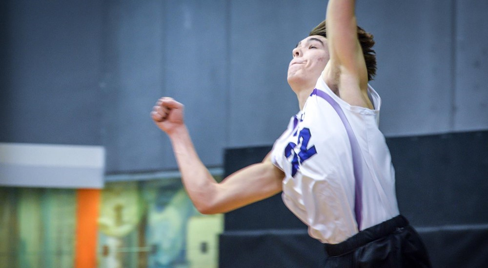 Evan Lindley scoring a kill, in the NYU volleyball team's 3-1 loss against Vassar College.