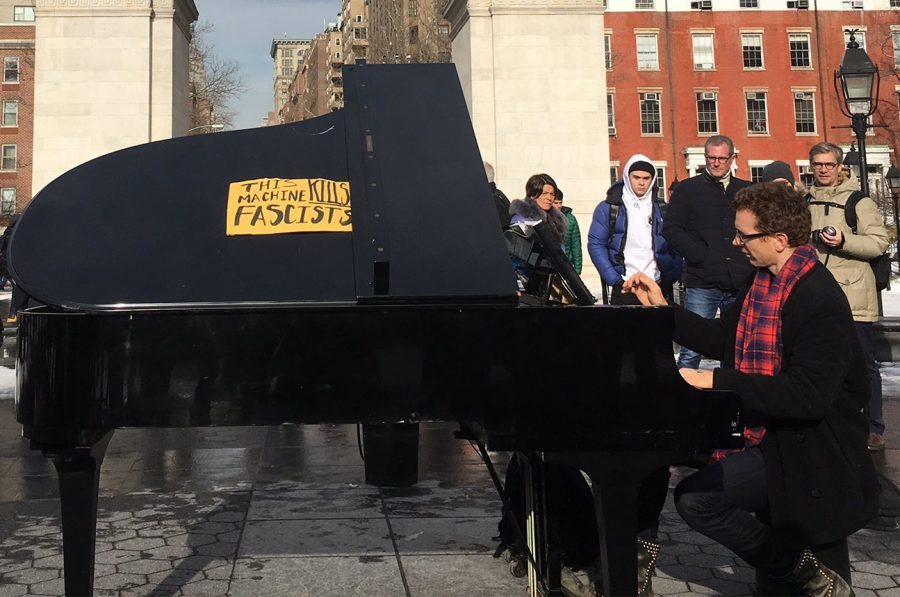 A+pianist+who+frequents+Washington+Square+Park+altered+his+instrument+with+a+sign+that+reads+%22this+machine+kills+fascism.%22+He+played+in+front+of+the+arch+as+people+gathered+to+record+his+music.