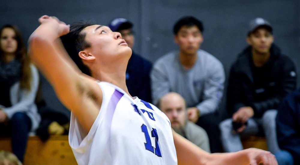 Stern freshman Adam Lee exemplifies his skills as the outside hitter by getting 10 kills during NYU's game against New Jersey City University on Feb. 22. In the end, the Violets demolished New Jersey City 3-0.