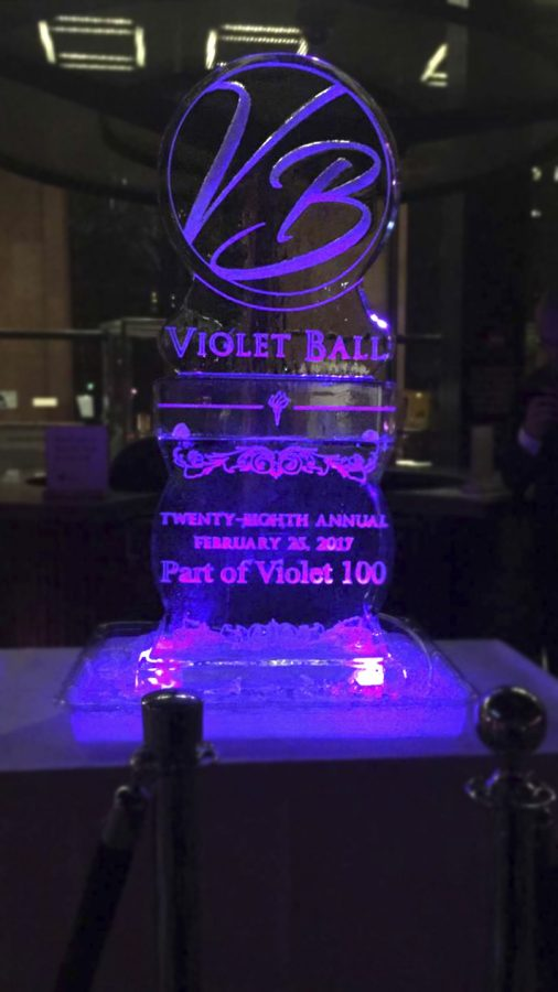 Students+gathered+around+the+ice+sculpture+in+the+atrium+of+Bobst+while+enjoying+the+annual+Violet+Ball.++The+event+took+place+on+Saturday%2C+February+26+as+part+of+Violet+100%27s+NYU+Spirit+Week.