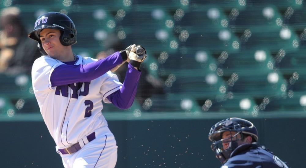 Jonathan Iaione bats against the University of Wisconsin-Stout, March 12. The NYU baseball team won this game and three others of seven In Fort Myers over spring break.