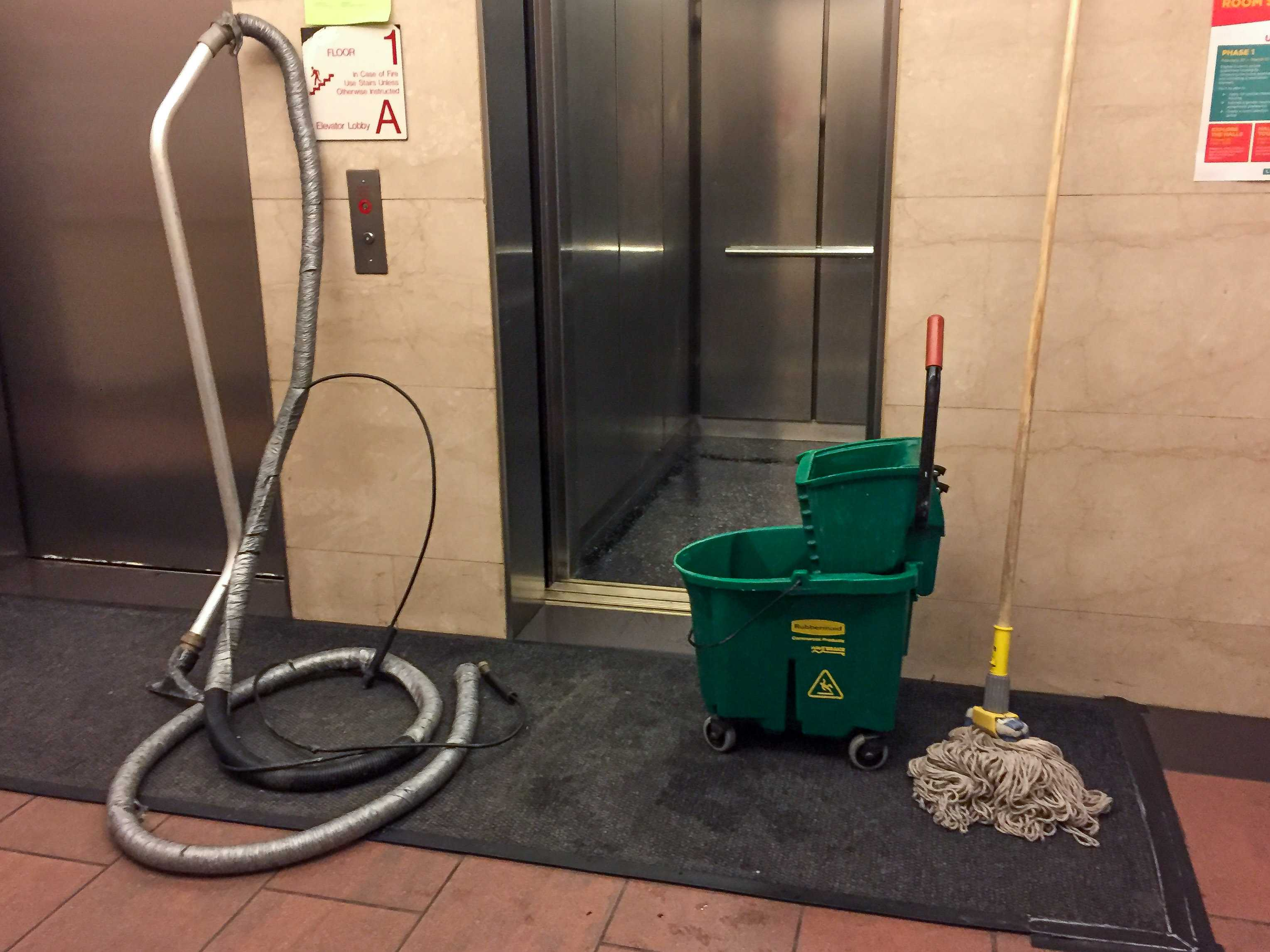 The Palladium Hall elevators being cleaned after water started leaking from the ceilings on Tuesday. The maintenance work has inconvenienced residents who have been forced to use the stairs to navigate the 16 floor building.