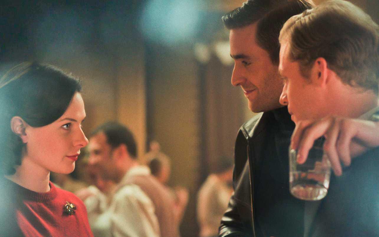"Rebecca Ferguson, Oliver Jackson-Cohen and Sam Reid, as Katya, Misha and Alexander in the British made Cold-War drama, ""Despite the Falling Snow."""