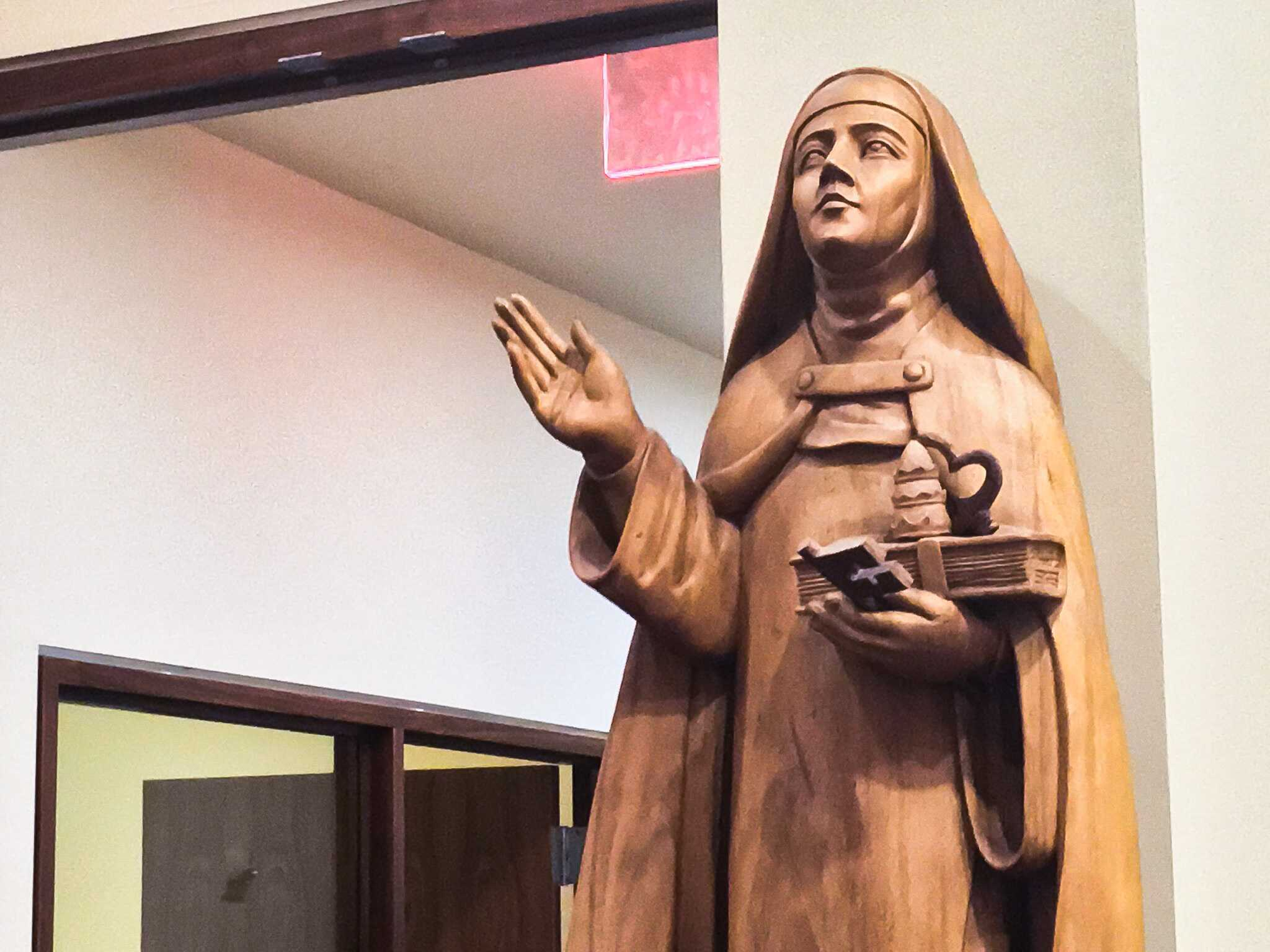 A statue in NYU's Catholic Center observes students as they make their decisions on what to give up for Lent.