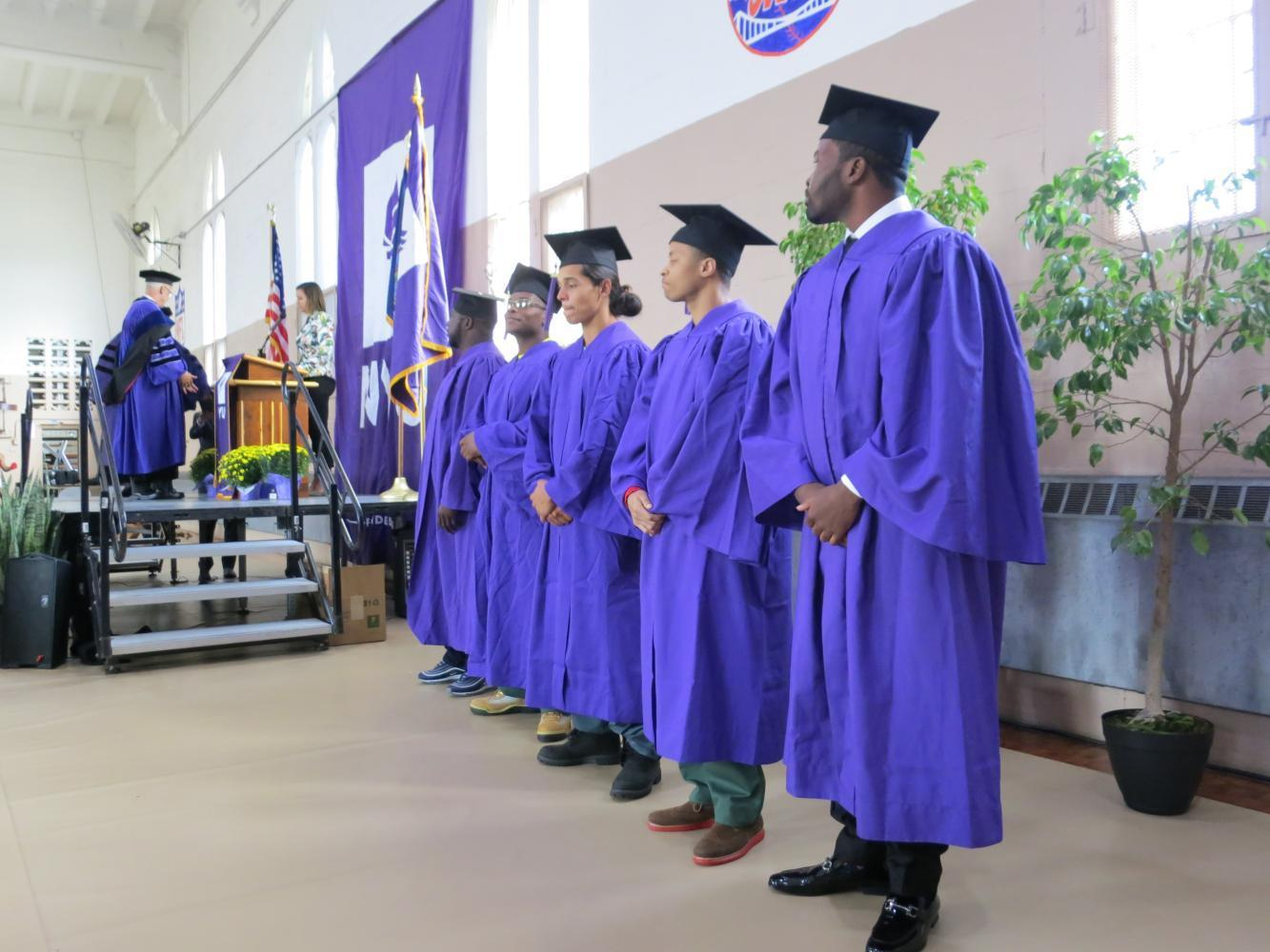 President Hamilton and Gallatin Dean Susanne Wofford attended the first graduation of NYU's Prison Education Program where five students received associate's degrees in Liberal Studies.