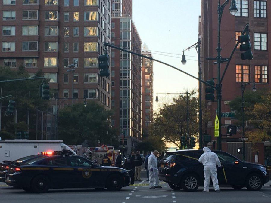 A+recent+attack+on+civilians+in+lower+manhattan+has+left+at+least+eight+dead+and+11+injured.+Forensics+and+police+gather+to+investigate+and+control+the+scene.+%0A