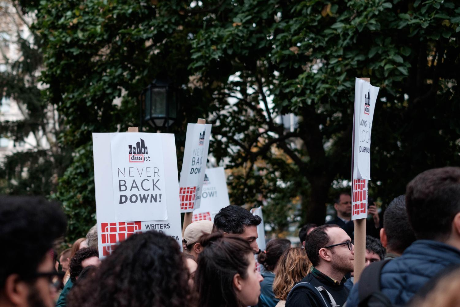 Approximately 200 people gathered to protest the shutdown of local news outlets DNAinfo and Gothamist on Nov.6 in City Hall Park.