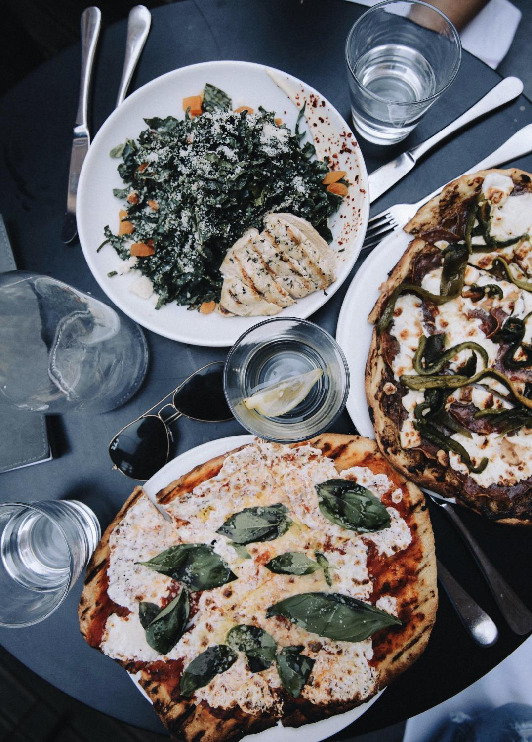 Flat lay photos of restaurant tables, aerial shots of plates and dishes, have become an Instagram staple to show off trendy foods.