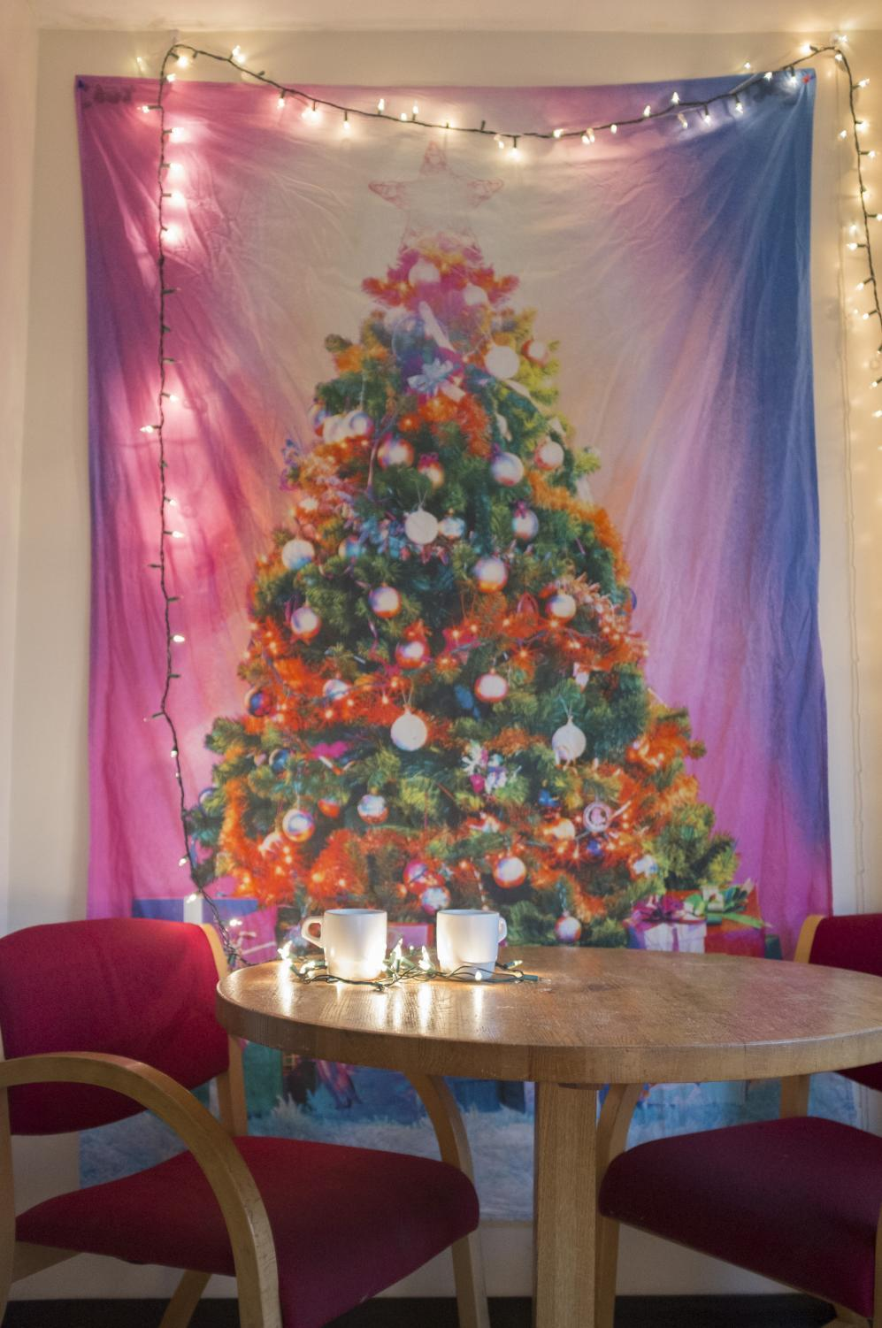 Festive tapestries are one way to decorate your dorm to celebrate Christmas.